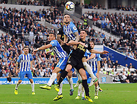 Football - 2017 / 2018 Premier League - Brighton & Hove Albion vs. Newcastle United<br /> <br /> Shane Duffy and Tomer Hemed of Brighton combine to out jump Ciaran Clark of Newcastle at The Amex.<br /> <br /> COLORSPORT/ANDREW COWIE