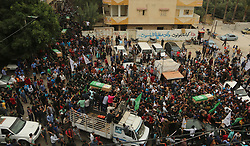 May 6, 2018 - Gaza, Palestinian Territories, Palestine - Palestinians mourners carry five of six bodies of al-Qassam fighters during their funeral in Deir Al Balah refugee camp, central Gaza Strip, 06 May 2018. Six fighetrs from al-Qassam brigades, the armed wing of Hamas movement, were killed a day earlier after an explosion in al-Zwaiydah neighborhood near Deir al-Balah town in the central Gaza Strip. (Credit Image: © Majdi Fathi/NurPhoto via ZUMA Press)