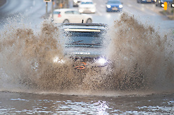 © Licensed to London News Pictures 20/07/2021. Maidstone, UK. The A20 London road in Aylesford near Maidstone is flooded tonight. Heatwave thunderstorms hit Kent causing flash flooding to roads. Photo credit:Grant Falvey/LNP