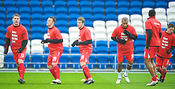 CARDIFF, WALES - Saturday, November 14, 2009: Wales players warm-up wearing 'Show Racism the Red Card' before the international friendly match against Scotland at the Cardiff City Stadium. L-R: Sam Vokes, Darcy Blake, Adam Matthews, Jermaine Easter. (Pic by David Rawcliffe/Propaganda)