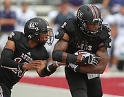 Lindenwood-Belleville QB Kerry Gibson (16, at left) hands off to RB Dominick Sherman (3) in first half action against Avila during the first football game in Lindenwood-Belleville history.
