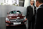 Staff members stand by Daimler AG Mercedes Benz vehicles during the China ( Guangzhou) International Automobile Exhibition in Guangzhou, Guangdong Province, China, on Monday, Nov. 21, 2011. Despite signs of slowing, China remains the largest and fastest growing market for international car makers, especially in the luxury sector.