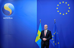 Fredrik Reinfeldt, Sweden's prime minister and standing president of the European Council, waits to receive EU heads of state arriving for the European Summit at EU Council headquarters in Brussels, Belgium, on Thursday, Nov. 19, 2009. European leaders will try to set divisions aside today as they choose their first-ever European Union president to represent the 27-nation bloc on the world stage. (Photo © Jock Fistick).