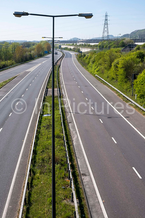 An empty M20 Motorway on the 15th of April 2020, Folkestone, United Kingdom. The M20 Motorway connects London to Dover and is the biggest and fastest road that connects London to the port. During the COVID-19 lockdown traffic on the road was significantly reduced.