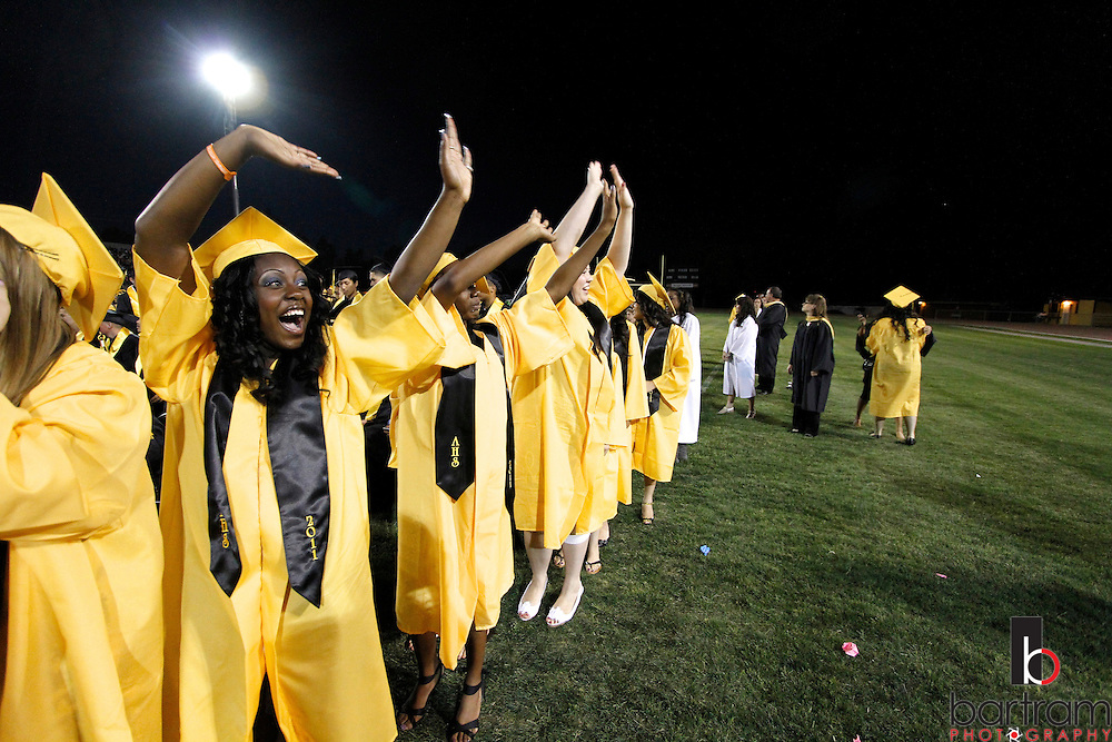 Antioch High School senior Shatori Hines and her classmates wave to the crowd during graduation on Friday, June 10, 2011 in Antioch. (Photo by Kevin Bartram)