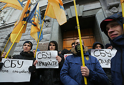 March 27, 2019 - Kiev, Ukraine - Young people hold the placards which say ''Its time to work'' and ''Medvedchuk - to jail'' as activists and supporters of National Corps far-right movement rally with demand to arrest Viktor Medvedchuk in front of Ukrainian Security Service head office building oin Kyiv,  Ukraine,  March 27, 2015. (Credit Image: © Sergii Kharchenko/NurPhoto via ZUMA Press)