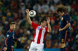 Nelson Valdez of Paraguay vs Carles Puyol of Spain during the  2010 FIFA World Cup South Africa Quarter Finals football match between Paraguay and Spain on July 03, 2010 at Ellis Park Stadium in Johannesburg. (Photo by Vid Ponikvar / Sportida)