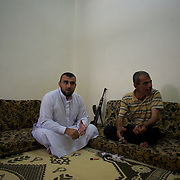 August 24, 2012 - Marea, Aleppo, Syria: Sheik Abu Mariam, commander of the recently created rebel militia Ibnu Walid, meets with some volunteer fighters in the village of Marea. The militia incorporates 25 fighters and has the intent to be an elite group to perform guerrilla style operations against syrian army troops in the province of Aleppo. (Paulo Nunes dos Santos/Polaris)