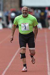 April 27, 2018 - Philadelphia, Pennsylvania, U.S - MOHAMED DIAA ABDELALL (3) grimaces in pain during his run in the Masters Men's 100m dash 70+ at Franklin Field in Philadelphia, Pennsylvania. (Credit Image: © Amy Sanderson via ZUMA Wire)