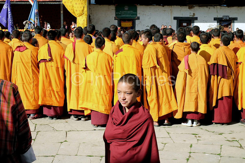 Monks at the Black-necked Crane festival at Gangte Goemba, Phobjikha Valley, Bhutan. Every year on November 11th, the local community hosts the Black-necked Crane festival at Gangte Goemba, to highlight its significance to the valley. Phobjikha Valley is the most significant overwintering ground of the rare and endangered Black-necked Crane in Bhutan.