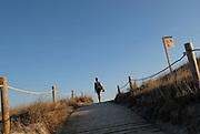 Young woman walking in Levante Beach - Platja de Llevant -, Formentera