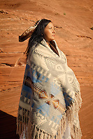 """Modern traditional Navajo woman.<br /> :::<br /> """"I have been to the end of the earth,<br /> I have been to the end of the waters,<br /> I have been to the end of the sky,<br /> I have been to the end of the mountains,<br /> I have found none <br /> that were not my friends<br /> - Traditional Navajo Song Native American Navajo Woman Yogini. Diné woman practicing yoga in her indigenous red earth environment."""