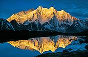 Dawn lights up Chomolonzo & Makalu, reflection from camp in Khama valley, east of Chomolungma, Tibet