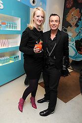 CAMILLA MORTON and JULIEN MACDONALD at a party to celebrate the publication of Camilla Morton's book 'A Year in High Heals' held at Bliss Spa, 60 Slaone Avenue, London on 5th February 2009.