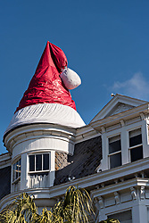 December 21, 2017 - Charleston, South Carolina, United States of America - A giant Santa Hat decorates the peaked roof on a historic home decorated for Christmas on Meeting Street in Charleston, SC. (Credit Image: © Richard Ellis via ZUMA Wire)