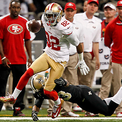 November 25, 2012; New Orleans, LA, USA; San Francisco 49ers wide receiver Mario Manningham (82) escapes a tackle by New Orleans Saints cornerback Jabari Greer (33) during the first quarter of a game at the Mercedes-Benz Superdome. The 49ers defeated the Saints 31-21. Mandatory Credit: Derick E. Hingle-US PRESSWIRE