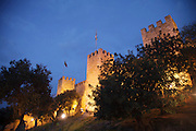 Saint George Castle in Lisbon at twilight. The strongly fortified citadel, which, in its present configuration, dates from medieval times, is located atop the highest hill in the historic center of the city. The castle is one of the main historical and touristic sites of Lisbon and it was conquered to the Moors by the first king of Portugal, D. Afonso Henriques, in 1147.