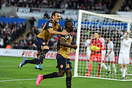 Joel Campbell of Arsenal celebrates with Santi Cazorla (l) after he scores his teams 3rd goal. Barclays Premier league match, Swansea city v Arsenal  at the Liberty Stadium in Swansea, South Wales  on Saturday 31st October 2015.<br /> pic by  Andrew Orchard, Andrew Orchard sports photography.