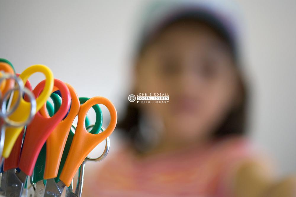 Pot of pairs of scissors in nursery school,