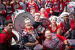 © Licensed to London News Pictures . 17/06/2018. Manchester , UK . The Batala drum and dance section pose for a photo . The 2018 Manchester Day parade , celebrating Manchester's cultural and social life and diversity, passes through Manchester City Centre . Photo credit : Joel Goodman/LNP
