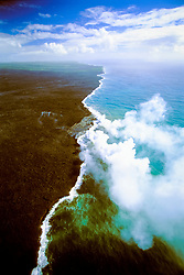 aerial view of coast line at Kilauea, creation of new land - hot lava flows into cold ocean creating large steam clouds, Hawaii, USA Volcanoes National Park, Kilauea, Big Island, Hawaii, USA, Pacific Ocean