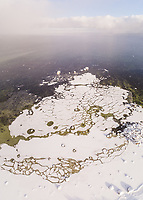 Abstract aerial view of windy snowy sea of Muraste in Estonia.
