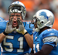 MORNING JOURNAL/DAVID RICHARD.Detroit center Dominic Raiola, left, taunts the Browns' fans while booing along with the crowd after Cleveland quarterback Trent Dilfer threw an interception yesterday in the fourth quarter.