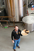 Christian Ettiger, owner of HUB, dishing up some grain.