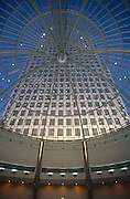 The One Canada Square is seen soon after its completion in the early-1990s. Seen from a low angle inside the dome of Cabot Square shopping mall, we see the tall building rising above us. Canary Wharf is the product of the 1980s financial boom when during the office of Prime Minister Margaret Thatcher, huge building projects such as the Docklands consortium saw vast changes in London's landscape. One Canada Square (often incorrectly called Canary Wharf, after its location) is a skyscraper in Canary Wharf, London. It was the tallest building in the United Kingdom from 1990 to 2010, standing at 235 metres (770 ft) above ground level and containing 50 storeys.
