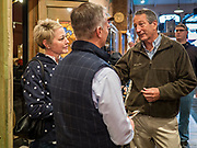 19 OCTOBER 2019 - DES MOINES, IOWA: MARK SANFORD (R-SC), right, talks customers in a Des Moines coffee shop during a campaign visit to Des Moines Saturday. Sanford, a former Republican governor and Congressman from South Carolina, is challenging incumbent President Donald Trump for the Republican nomination for the US presidency. Iowa hosts the first event of the presidential selection cycle. The Iowa Caucuses are scheduled for February 3, 2020.              PHOTO BY JACK KURTZ