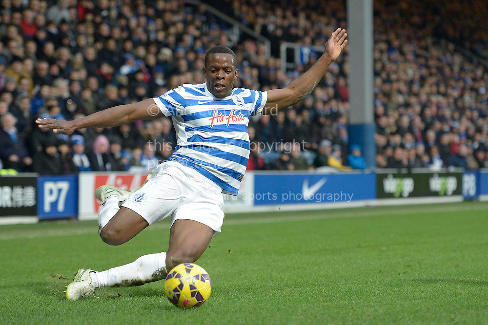 Nedum Onuoha of QPR attempting to keep the ball in play. Barclays Premier league match, Queens Park Rangers v Southampton at Loftus Road in London on Saturday 7th Feb 2015. pic by John Patrick Fletcher, Andrew Orchard sports photography.