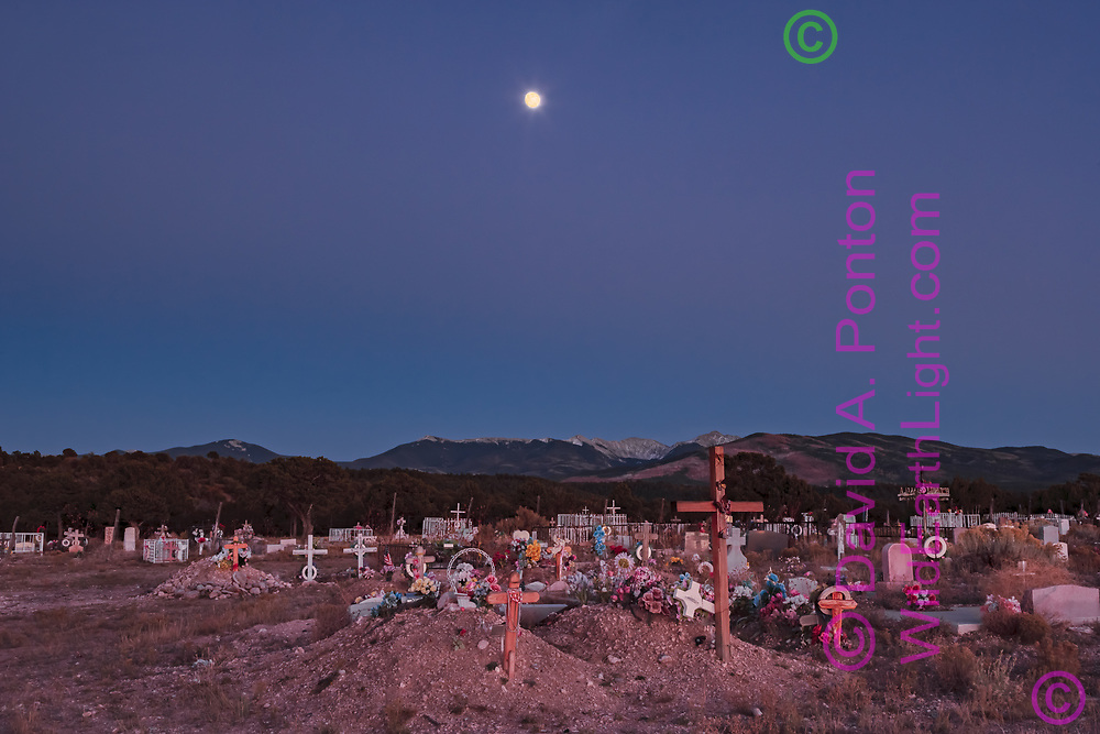 Truchas graveyard with moon and Sangre de Cristo Mountains, after sunset, New Mexico, © 2007 David A. Ponton