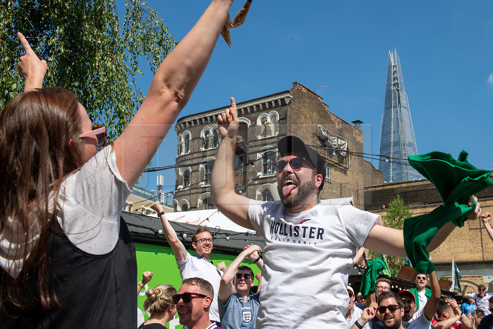 © Licensed to London News Pictures. 13/06/2021. London, UK. Football fans celebrate an England goal at Flat Iron Square in central London during the England v Croatia Euro 2020 Group D match played at Wembley Stadium. Photo credit: Peter Manning/LNP