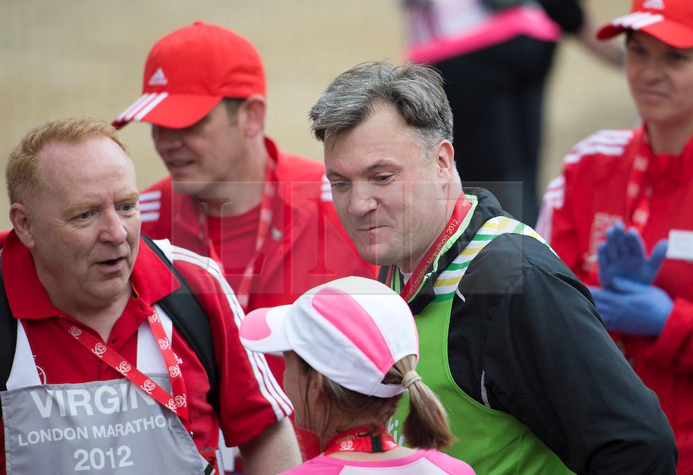 © London News Pictures. 22/04/2012. London, UK. Labour MP Ed Balls crosses the finnish line at the 2012 Virgin London Marathon in London on April 22, 2012. Photo credit : Ben Cawthra /LNP
