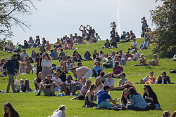 © Licensed to London News Pictures. 30/05/2021. London, UK. Public enjoy the sunny weather during bank holiday in Primrose Hill, north London.  Photo credit: Marcin Nowak/LNP