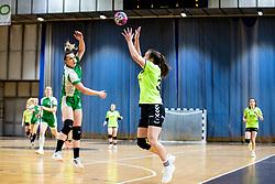 Erin Novak of ZRK Krka Novo Mesto and Hana Gabrovsek of RK Olimpija during handball match between RK Olimpija and ZRK Krka Novo Mesto in Round #10 of National Youth League in Season 2020-21, on May 2, 2021 in Hala Tivoli, Ljubljana, Slovenia. Photo by Matic Klansek Velej / Sportida
