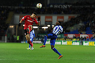 Cardiff city's Rudy Gestede (l) battles for the ball with Wed's Jeremy Helan. NPower championship, Cardiff city v Sheffield Wednesday at the Cardiff city Stadium in Cardiff on Sunday 2nd Dec 2012. pic by Andrew Orchard, Andrew Orchard sports photography,