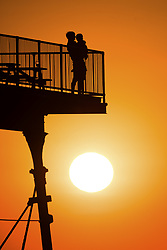 July 3, 2018 - Aberystwyth, Wales - Aberystwyth, UK. A day of unbroken blue skies and searing  heat comes to a beautiful end with people on the seaside pier watching a glorious sunset over Cardigan Bay off Aberystwyth on the west coast of Wales. (Credit Image: © Keith Morris/London News Pictures via ZUMA Wire)