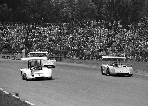 """John Surtees, Chaparral McLaren M12, gives way to the """"Bruce and Denny Show"""" at 1969 Watkins Glen Can-Am; Photo by Pete Lyons 1969/ © 2014 Pete Lyons / petelyons.com"""