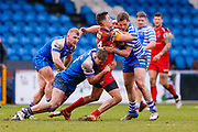 Halifax RLFC centre Chester Butler (18) stops London Broncos full back Alex Walker (14)  during the Betfred Championship match between Halifax RLFC and London Broncos at the MBi Shay Stadium, Halifax, United Kingdom on 8 April 2018. Picture by Simon Davies.