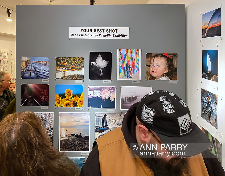 Huntington, New York, U.S. February 29, 2020.  Push-pins are used to display the photographs exhibited in fotofoto gallery's 'Your Best Shot' Open Photography exhibition, seen during its Reception.
