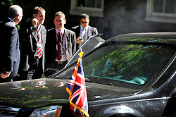 © licensed to London News Pictures. LONDON, UK  25/05/11. Smoke comes from under the hood of the Presidnet's 2nd car. Barak Obama and David Cameron meet in Downing Street during US President Obama's first State Visit to the United Kingdom. Please see special instructions. Photo credit should read Stephen Simpson/LNP