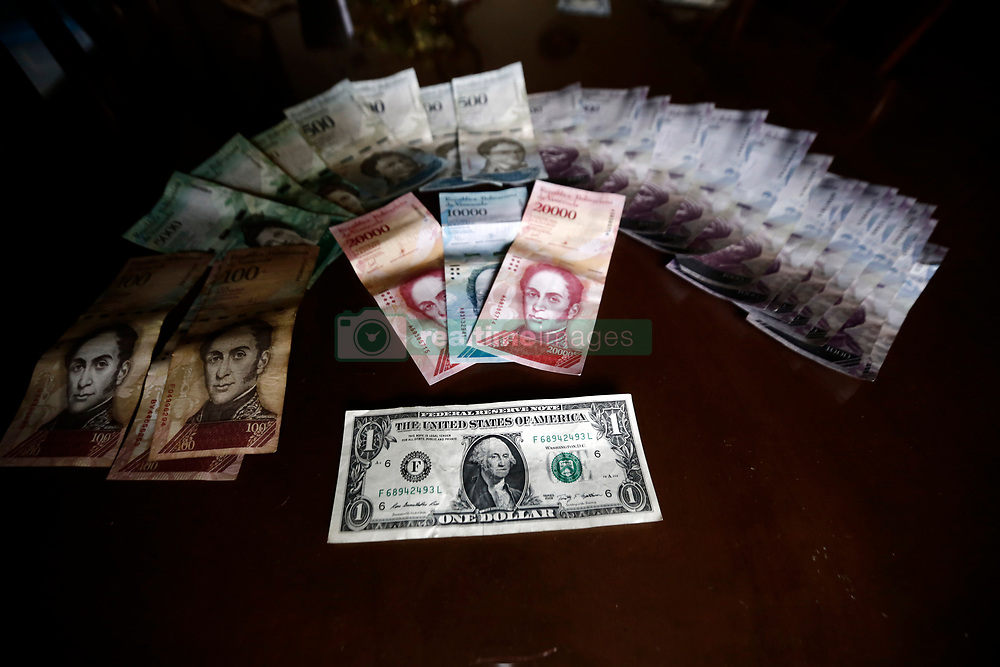 July 6, 2018 - Valencia, Carabobo, Venezuela - July 06, 2018. The dollar feels a rise in the payment rates of exchange houses controlled by the Venezuelan government, from 2.200.000, or 2.500.000, or for family remittances according to the adjunct made by the most recent Dicom auction, the currency system at a complementary exchange rate, which is still far from the reality of the parallel dollar fixed on the street at various prices ranging from 3. 600.000, or 4.000.000, or for today. The minimum integral salary of a Venezuelan is set at Bs. 5,196,000, or, which would give a lower proportion of 2 dollars per month. Photo: Juan Carlos Hernandez (Credit Image: © Juan Carlos Hernandez via ZUMA Wire)