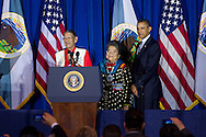 U.S. President Barack Obama thanks Sonny and Mary Black Eagle, his 'adoptive parents' from the Crow Tribe during the 2011 White House Tribal Nations Conference  which he hosted at the Department of the Interior in Washington, DC on December 2nd, 2011.