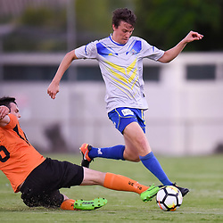 BRISBANE, AUSTRALIA - JANUARY 8: Trent Clulow of Strikers is tackled by Grant Brix of Easts during the Kappa Silver Boot Group A match between Brisbane Strikers and Eastern Suburbs on January 8, 2017 in Brisbane, Australia. (Photo by Patrick Kearney)