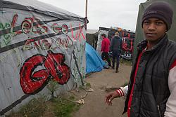 """Calais, Pas-de-Calais, France - 16.10.2016    <br />     <br /> """"Lets go England""""-slogan on a tent in the """"Jungle"""" refugee camp on the outskirts of the French city of Calais. Many thousands of migrants and refugees are waiting in some cases for years in the port city in the hope of being able to cross the English Channel to Britain. French authorities announced that they will shortly evict the camp where currently up to up to 10,000 people live.<br /> <br /> """"Lets go England""""-Schriftzug an einer Zeltwand im """"Jungle"""" Fluechtlingscamp am Rande der franzoesischen Stadt Calais. Viele tausend Migranten und Fluechtlinge harren teilweise seit Jahren in der Hafenstadt aus in der Hoffnung den Aermelkanal nach Großbritannien ueberqueren zu koennen. Die franzoesischen Behoerden kuendigten an, dass sie das Camp, indem derzeit bis zu bis zu 10.000 Menschen leben Kürze raeumen werden. <br /> <br /> Photo: Bjoern Kietzmann"""