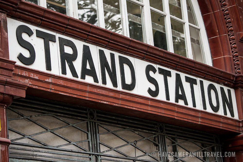 An historic sign for Strand Station London Underground stop, now disused and boarded up.