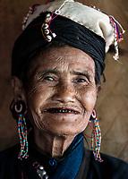 KYAING TONG, MYANMAR - CIRCA DECEMBER 2017: Portrait of old woman at the Pan Ian Village, Enn tribe also known as Eng or Black Teeth around Kyaing Tong