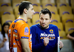 Andrej Flajs of ACH talks to Luka Slabe, head coach of ACH during volleyball game between OK ACH Volley and OK Panvita Pomgrad in 1st final match of Slovenian National Championship 2013/14, on April 6, 2014 in Arena Tivoli, Ljubljana, Slovenia. Photo by Vid Ponikvar / Sportida