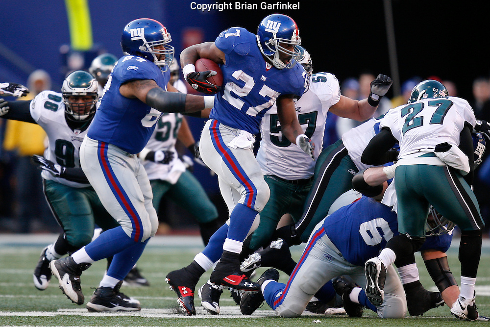 11 Jan 2009: New York Giants running back Brandon Jacobs #27 runs the ball through traffic during the game against the Philadelphia Eagles on January 11th, 2009.  The  Eagles won 23-11 at Giants Stadium in East Rutherford, New Jersey.